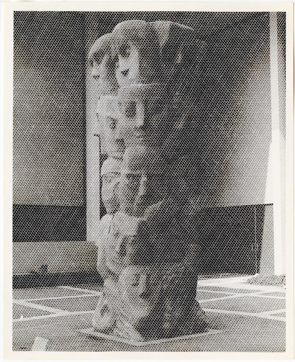 """Tower of Masks"" statue scultped by Anna Mahler in Theater Arts court"