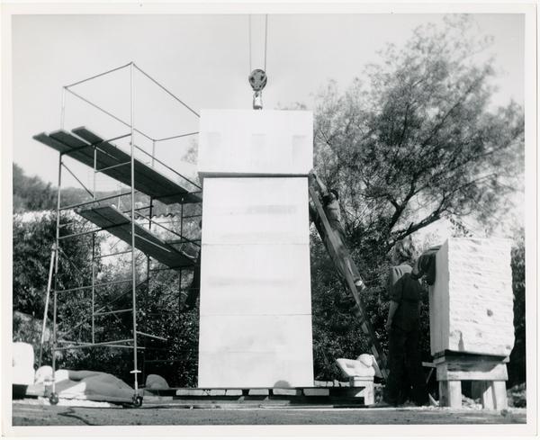Installation of limestone column for Anna Mahler's scultpture
