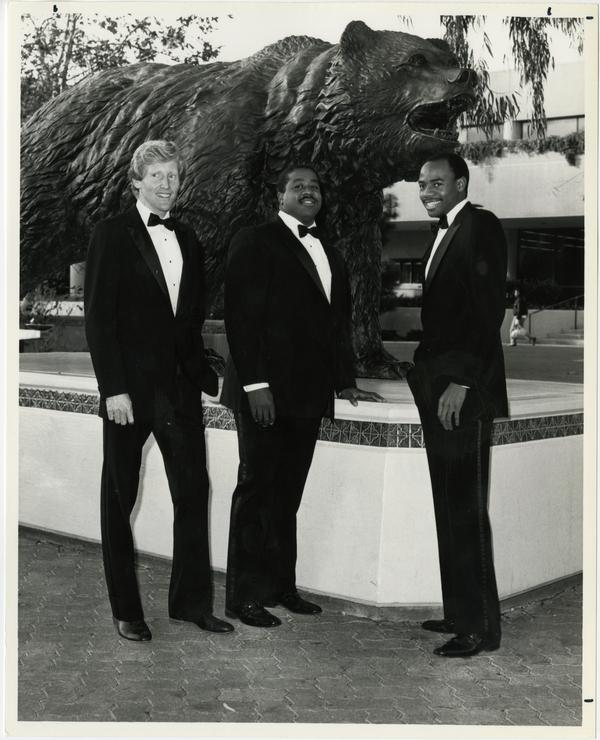 UCLA Track seniors in front of bear statue, ca. 1986