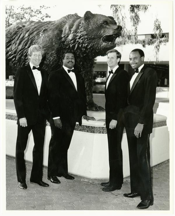 UCLA Track seniors in front of bear statue