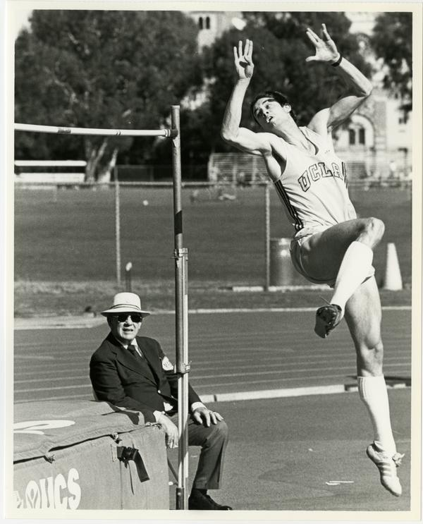 UCLA track team member pole vaulting