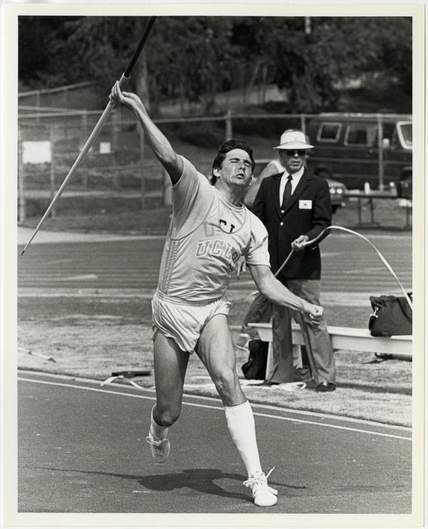 UCLA track team member throwing javelin