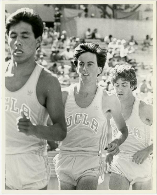 UCLA track team members running