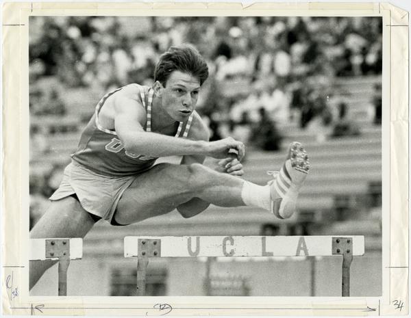 Steve Kerho jumping over hurdle
