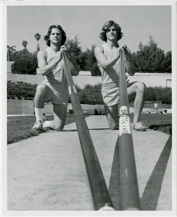 Tim Curran and Mike Tully with poles, ca. 1978