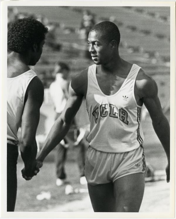Dwayne Washington shaking hands