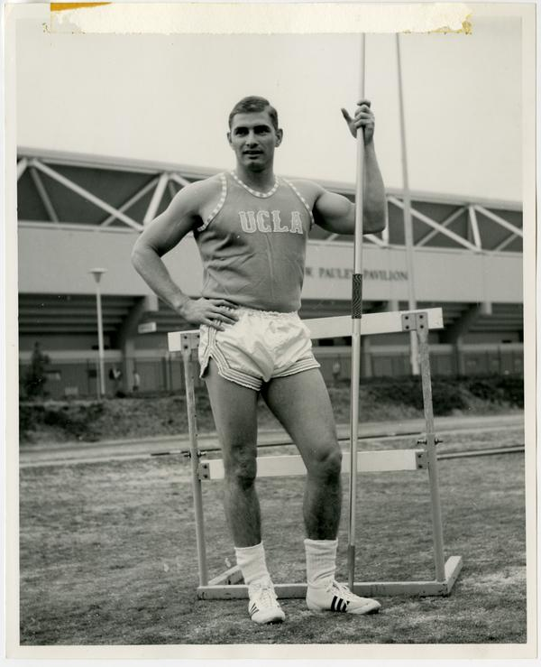 Track team member posing outside of Pauley Pavilion