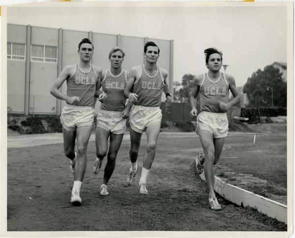 Track team members running