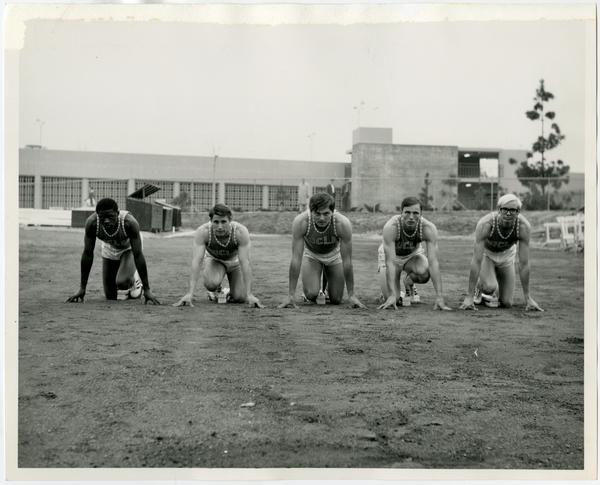 Track team members posing