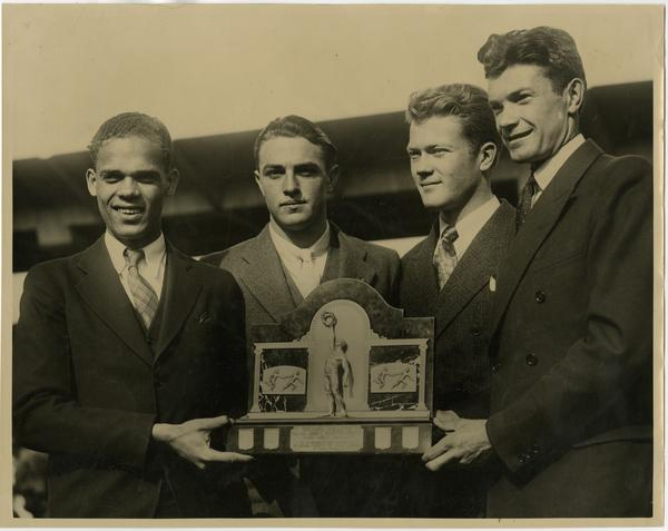 One mile University class champions James Lu Valle, Ray Vejar, Sinclair Lott, and James Miller in De Moines, Iowa at Drake Relays, ca. 1934
