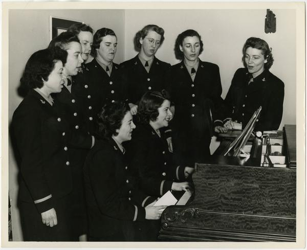 Group of women around piano