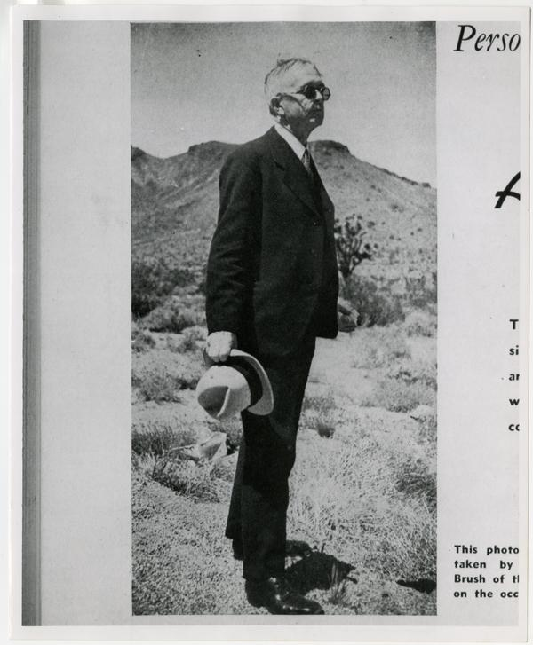 Arthur P. McKinlay standing in brush