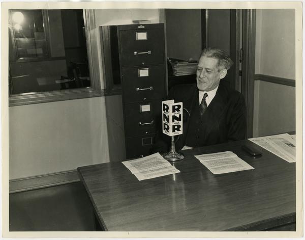 Provost Earle Hedrick sitting at desk