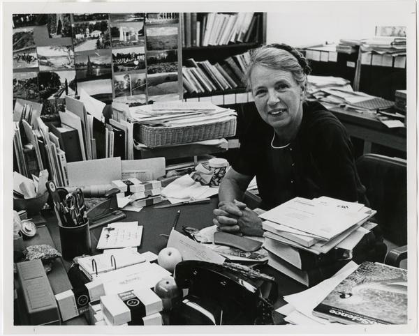Dr. Mildred Mathias at desk