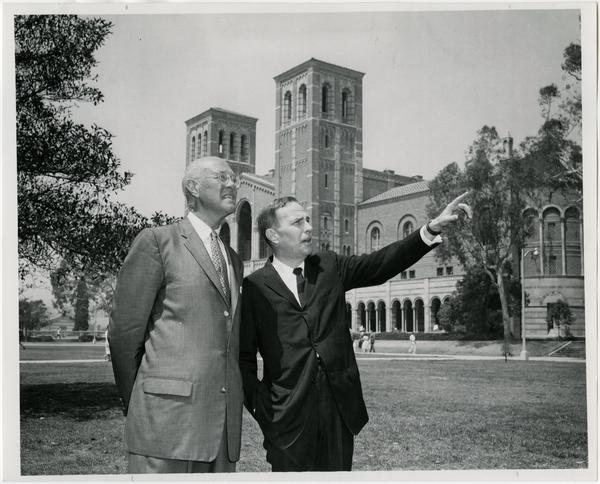 Chancellor Murphy pointing at something for Professor Knudsen with Royce Hall in background