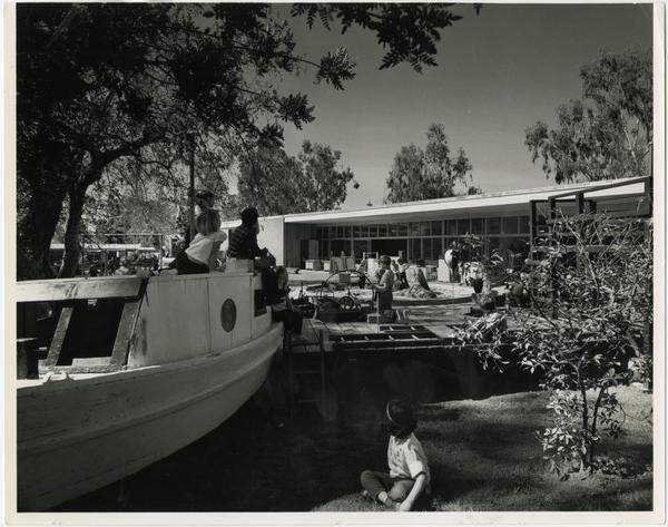 Children playing on boat in playground