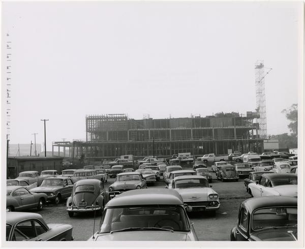 View of parking lot with partially constructed University Research Library in background
