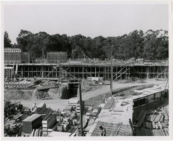 View of partial construction of the University Research Library with workers in the foreground