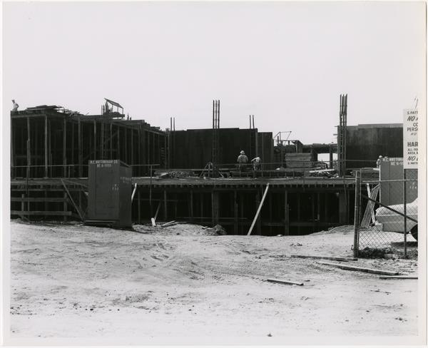View of partial construction of the University Research Library with workers