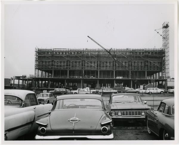 View of construction of the University Research Library from parking lot