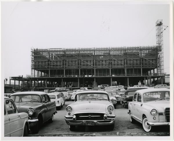 Side view of University Research Library during its construction from parking lot