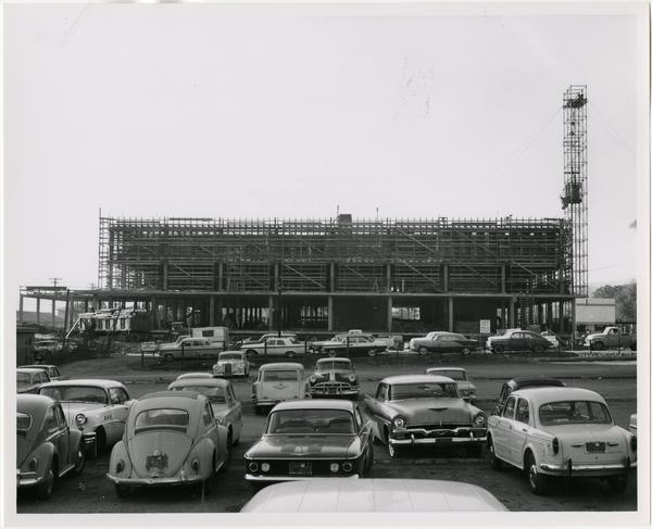 Side view of the construction of the University Research Library from parking lot