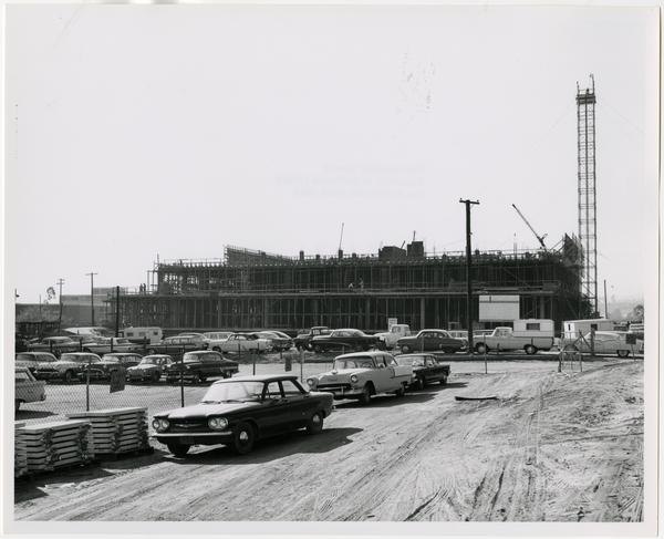 Side view of the construction of the University Research Library from the direction of Mcgowan Hall