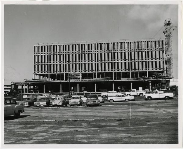 Side view of the University Research Library while in construction from parking lot