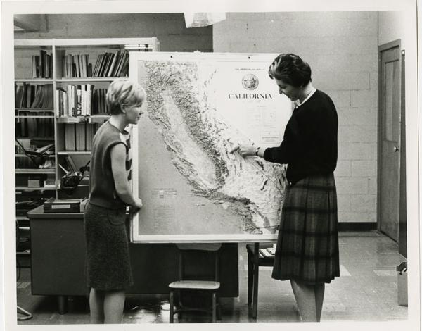 Students looking at California map, ca. 1965