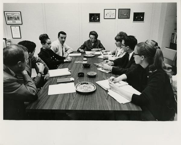 Students sitting around a table, ca. 1965