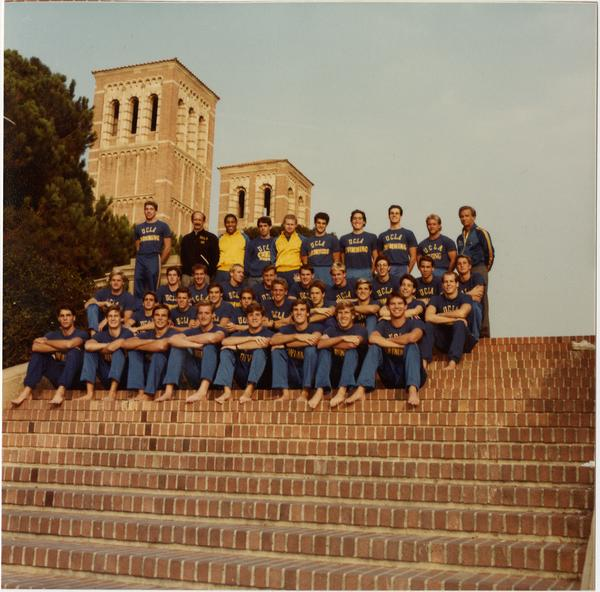 Portrait of Men's Swim Team on Janss Steps with Royce Hall in background