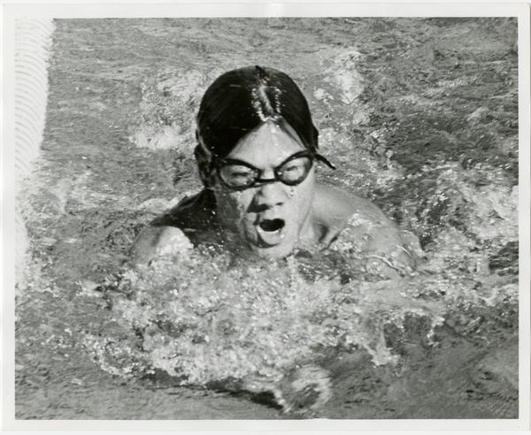 UCLA swim team member, Chris Woo, swimming, ca. 1979