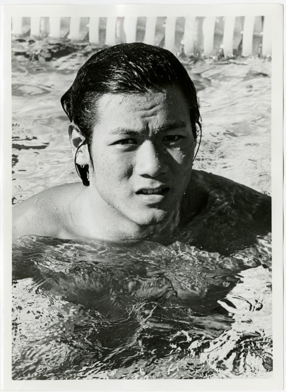 UCLA swim team member, Chris Woo in pool, ca. 1979