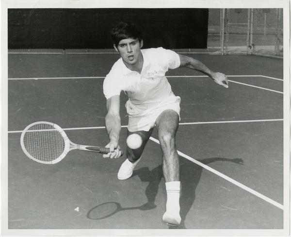 NCAA champion, Jeff Borowiak, hitting ball with raquet, ca. 1970s