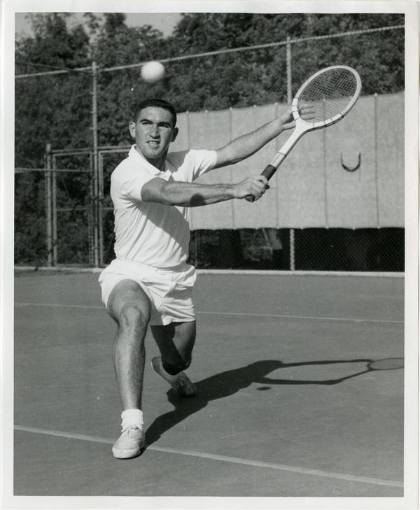 NCAA champion, Allen Fox, hitting ball with raquet, ca. 1960s