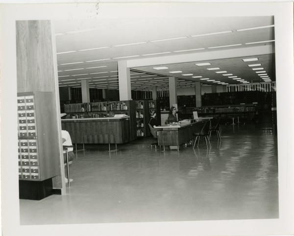 Students sitting at a table in the University Research Library