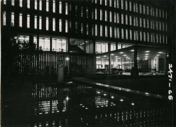 University Research Library with its lights on at night