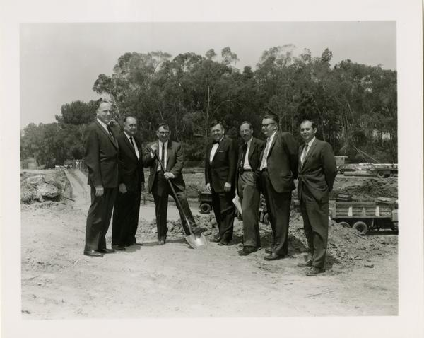 William G. Young, Robert Vosper, and others posing on the site of the new University Research Library during the groundbreaking ceremony, April 26, 1926