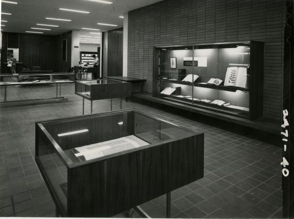 Display of libarry materials in glass cases in the University Research Library, ca. 1964