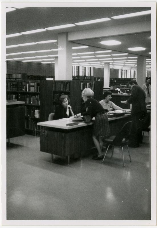 Reference staff member assisting a patron at the University Research Library, ca. 1968