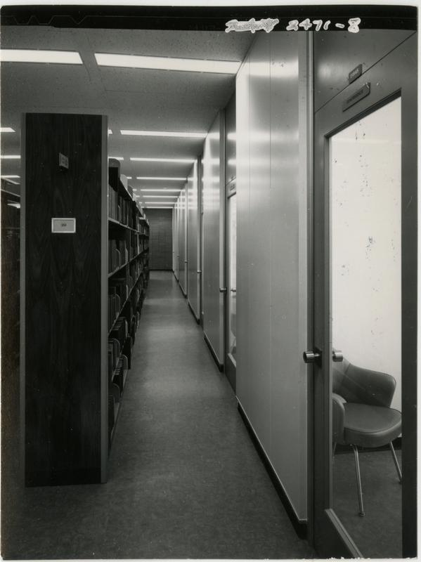 Looking down a corridor of the University Research Library next to the stacks, ca. 1964