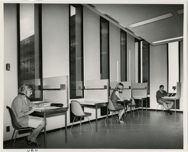 Students studying at desks in the University Research Library, ca. 1964