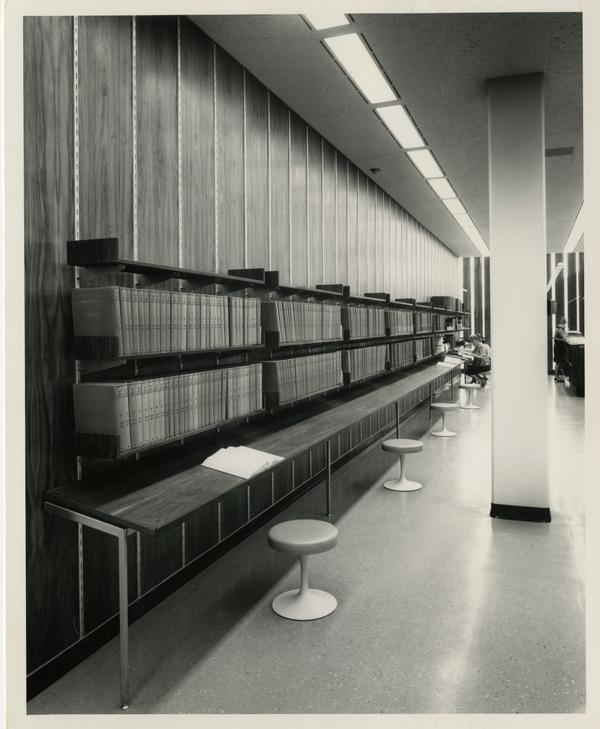 Long desk with a shelves of books above it for students to work at, University Research Library, ca. 1964