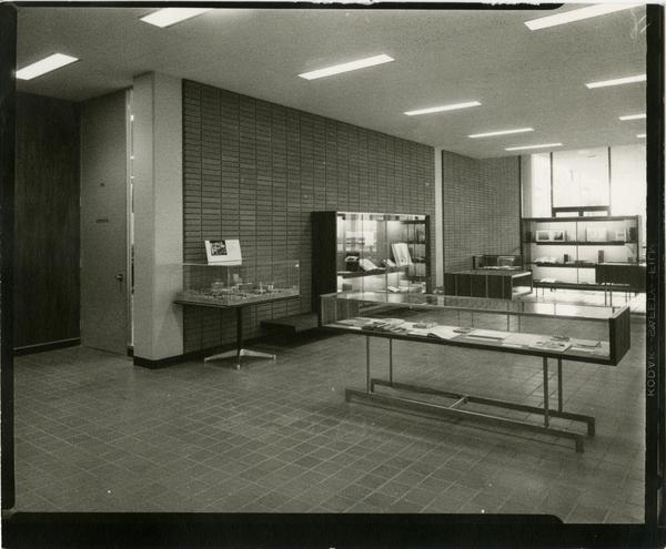 Contact print of display cases in the University Research Library, ca. 1964