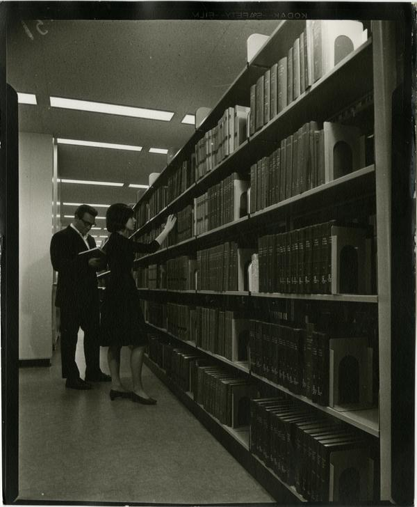 Contact print of library patrons browsing University Research Library stacks, ca. 1964
