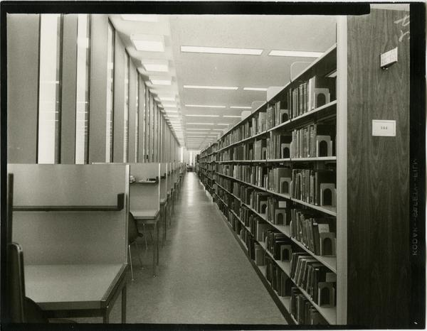 Contact print of stacks alongside study cubicles, ca. 1964