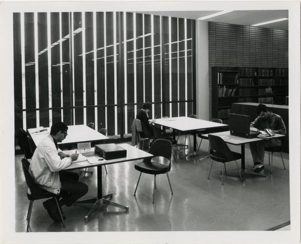 Students studying at tables in University Research Library, ca. 1964
