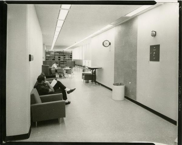 Contact print of students studying in hallway of University Research Library, ca. 1964
