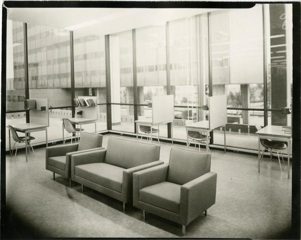 Contact print of desks and couches in University Research Library, ca. 1964