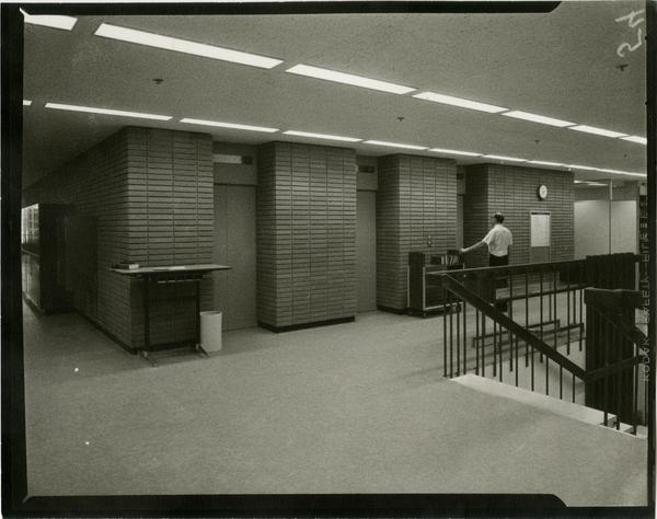 Contact print of second floor elevators in University Research Library, ca. 1964